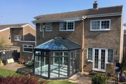 Outdoor view of house with conservatory