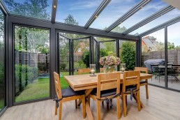 Conservatory with open doors and dining table
