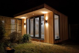 Garden room at night with lights