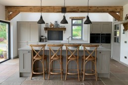 Fitted kitchen with chairs