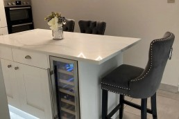 Fitted kitchen with chair